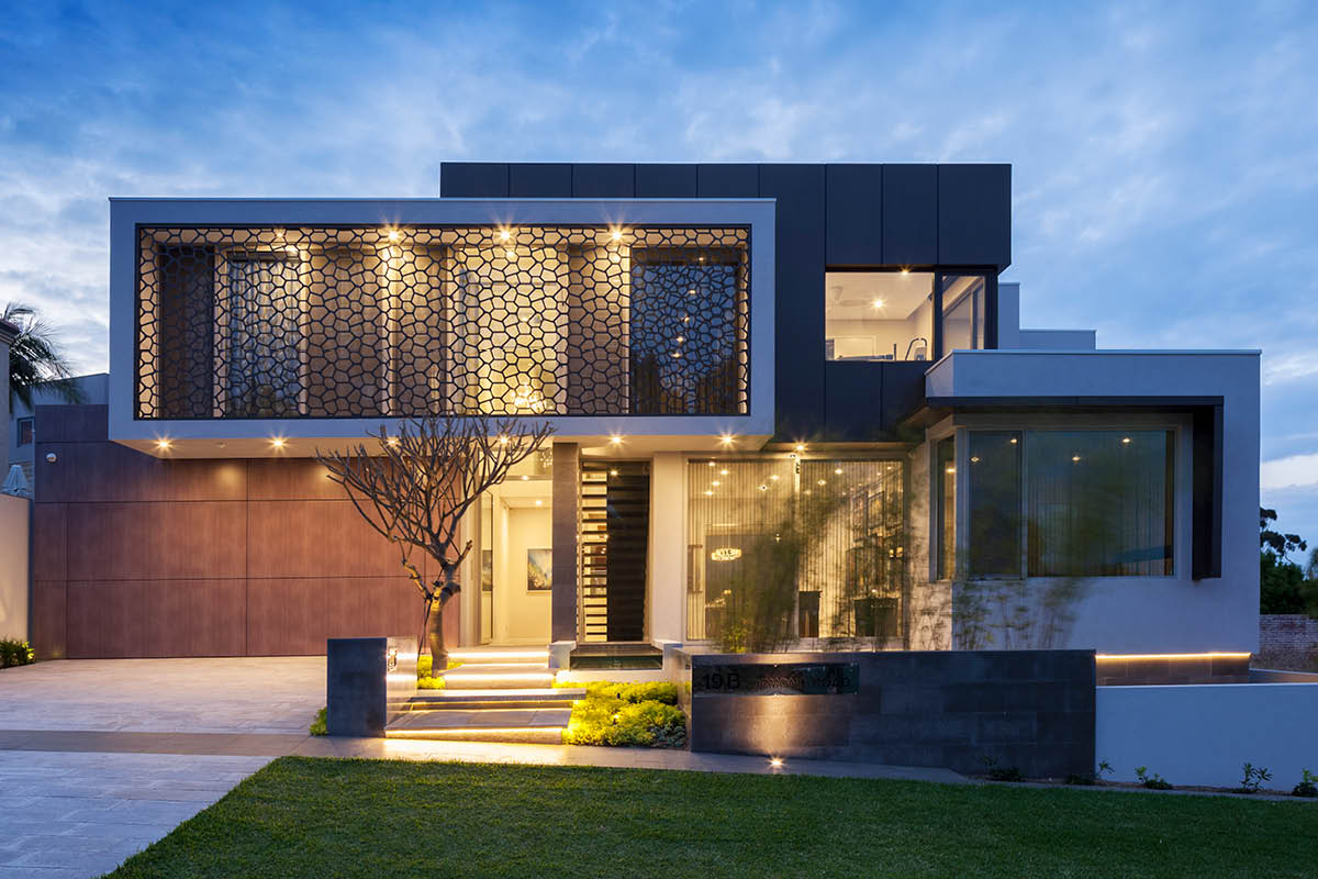 Modern architectural house front yard with lighting timber garage door and architectural feature grill on first floor