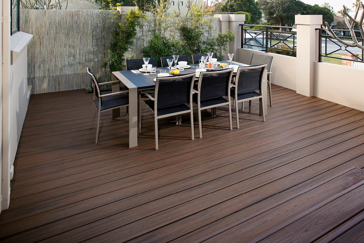 Trex composite deck with outdoor dining table set for entertaining