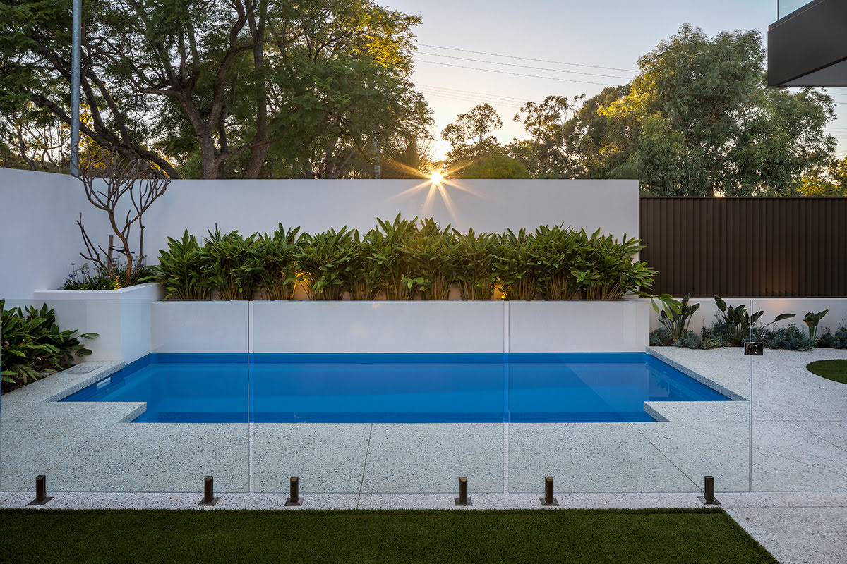 Raised garden beds around a fibreglass pool.